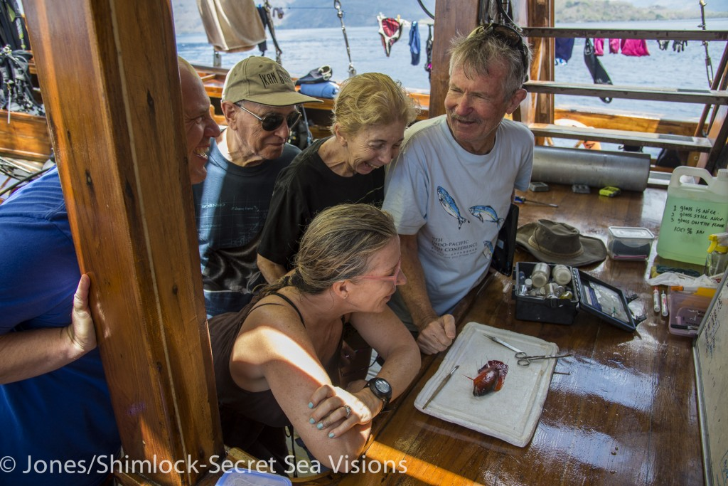 While guests, including Mickey and Ellen (center) look on, Dr. Allen waxes eloquently about a newly collected species