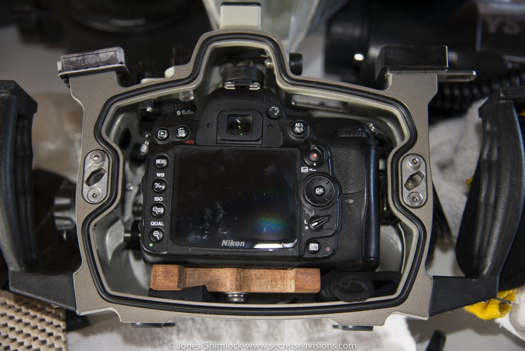 Camera with wooden tray and wetsuit shims