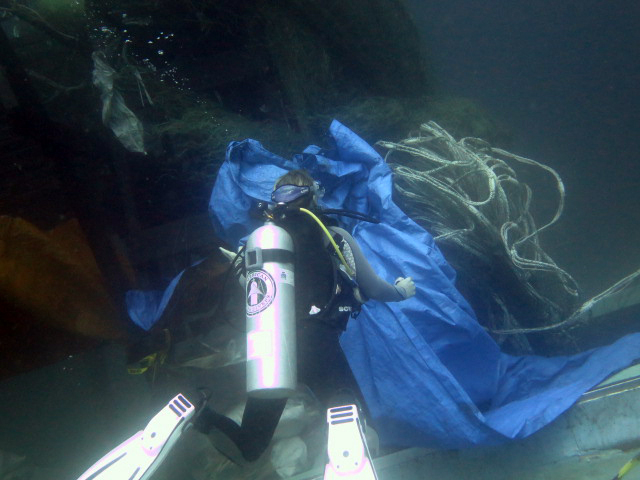 Diver helps remove nets