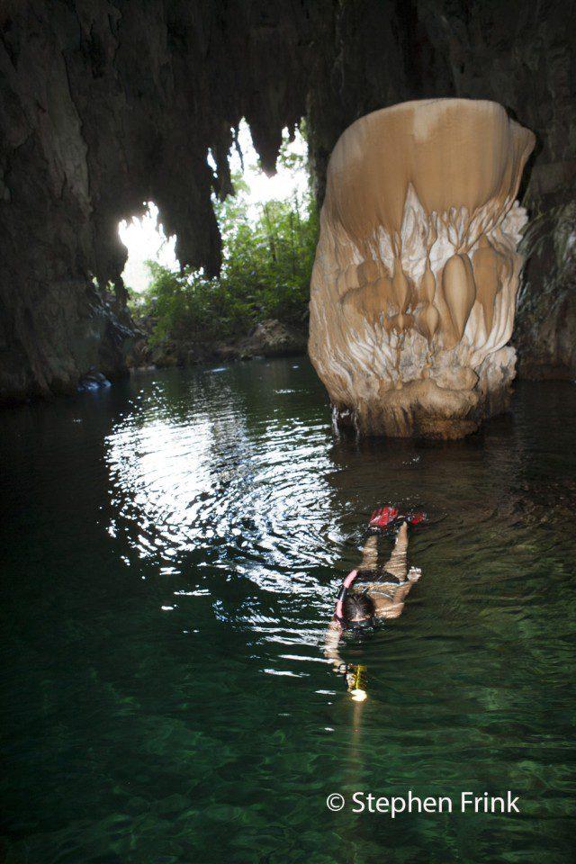 Snorkeler in Tomolol Cave, Misool Islands