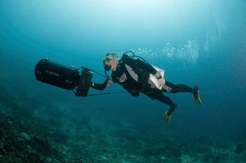Dr. Gerry Allen using an underwater propulsion device (scooter) to survey the reefs during a marine expedition to Halmahera, North Maluku Province (© Conservation International/photo by Sterling Zumbrunn)